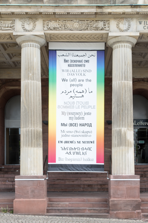 Hans Haacke, Wir (alle) sind das Volk—We (all) are the people, 2003/2017, five banners, installation view, Friedrichsplatz, Kassel, © Hans Haacke/VG Bild-Kunst, Bonn 2017, documenta 14, photo: Roman März This artist is represented by VG Bild-Kunst. For high-resolution images, please send a request to: presse@documenta.de.